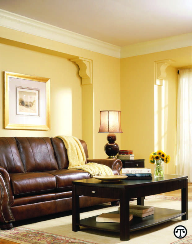 Simple Small Living Room Design With Yellow Wall Painting Vintage Brown  Sofa And Wooden Black Table