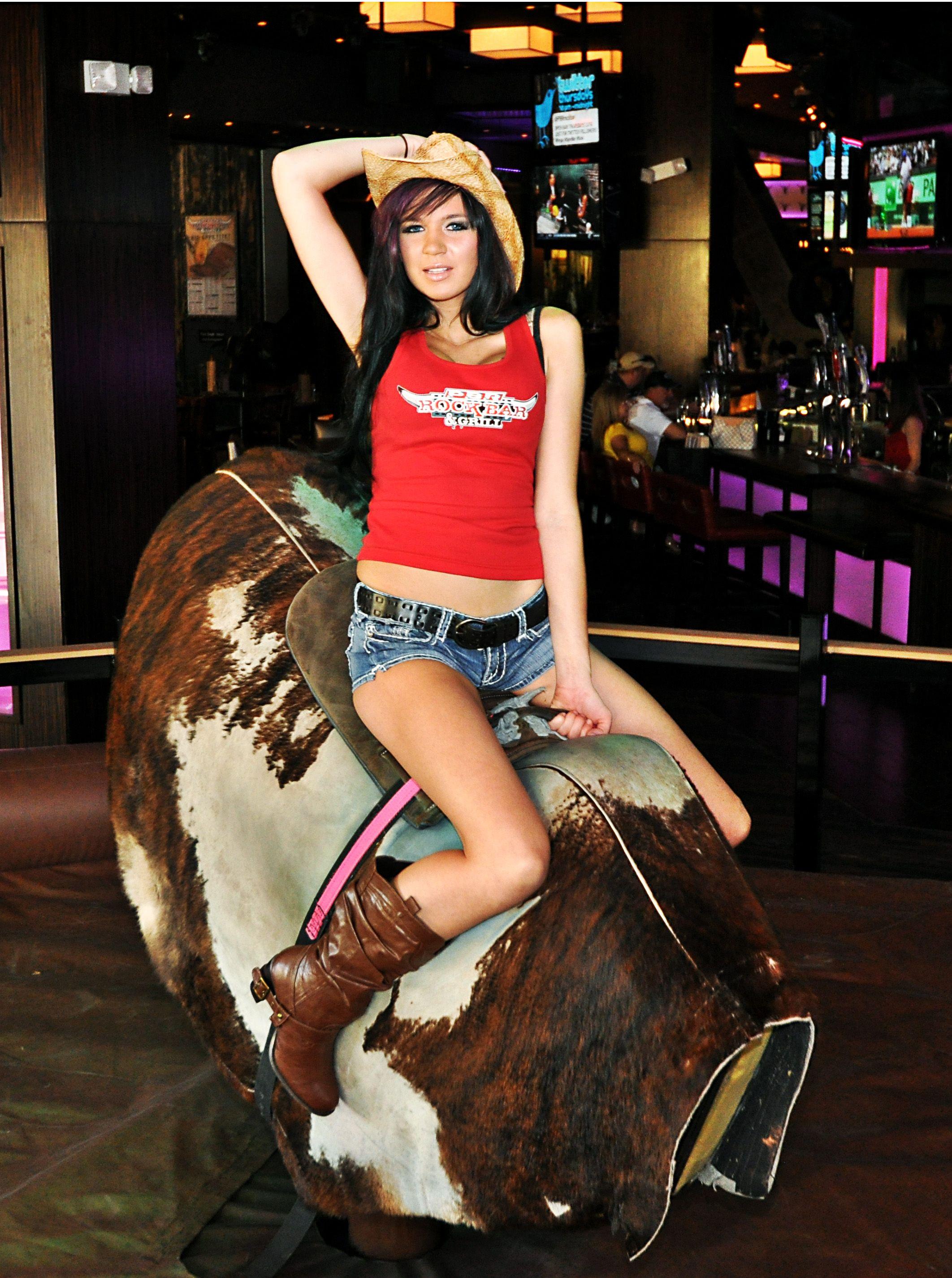 Naked girls bull riding
