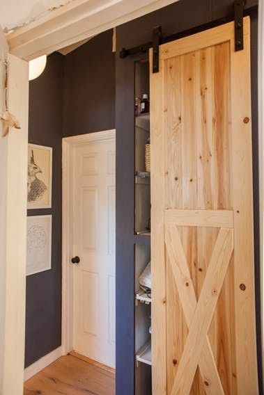 Jennifer Added This Sliding Barn Door To Hide A Small