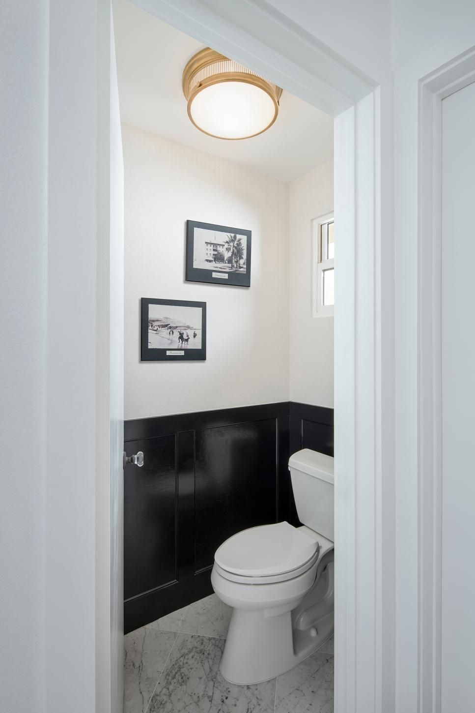 Black Wainscoting Gives Tailored Definition To This Powder Room Vintage Black And White Photographs Are A Urban Bathroom Black Wainscoting Wainscoting Bedroom