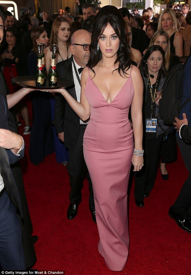 Katy Perry wears a low-cut dress on the Golden Globes red