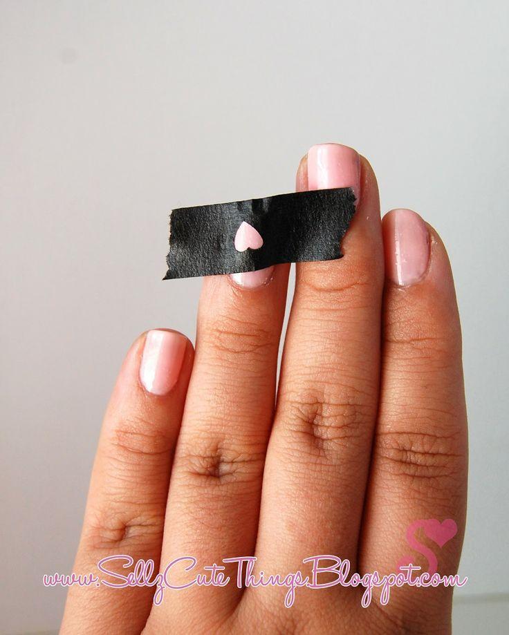 Use hole puncher and masking tape to make shapes on nail polish that 39 s i - Masking tape utilisation ...