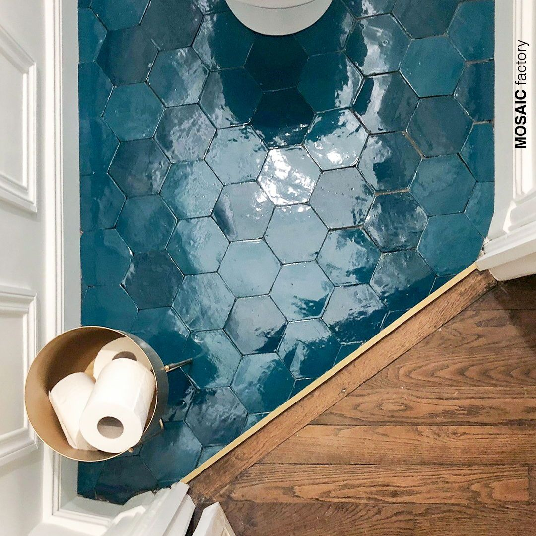 Bathroom floor with hexagonal turquoise CELLY tiles by Mosaic Factory. The…