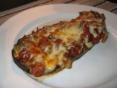 My Mom made the most delicious Egg Plant Parmesan and here is her recipe. Yes if you'll click the photo you'll find the best recipe you'll ever taste in your life for Egg Plant Parmesan. You just have to try this oh so wonderful recipe. If you have too many zuchinni squash right now try making it out of them. Please share with your family and friends. Because this is the best recipe ever.