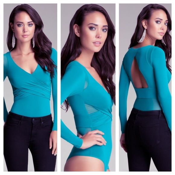 Bebe Longsleeve Surplice Bust Bodysuit Can fit a person who wears a medium or large. Snap button closure at the bottom. Has mesh around the shoulders and mesh detailing in the lower back. Worn twice, like new. (Please note that the color is a greenish blue) bebe Tops