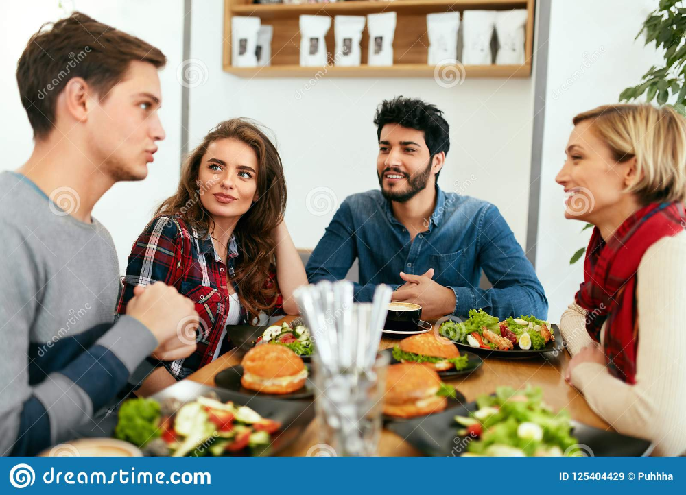 Photo About People Having Dinner Together At Table In Cafe Happy Friends Eating Food At Restaurant High Resolution Image Of Lifestyle Food Dinner Eat Food