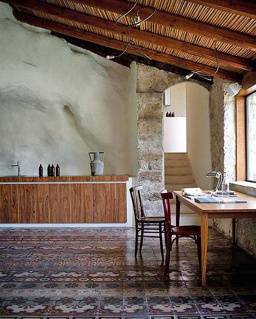 Casa Talia in Sicily, Italy-- typical of the Sicilian tradition: stone walls, lime plasters, cane roof, stone and polychrom tiled floors.
