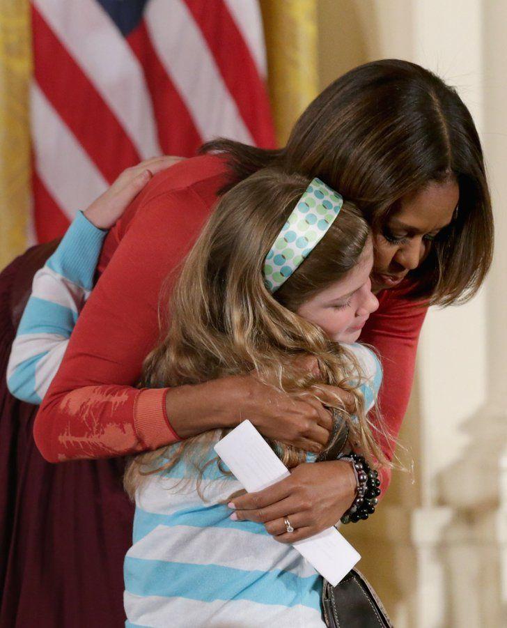 surprise embrace big hugs michelle obama and hug