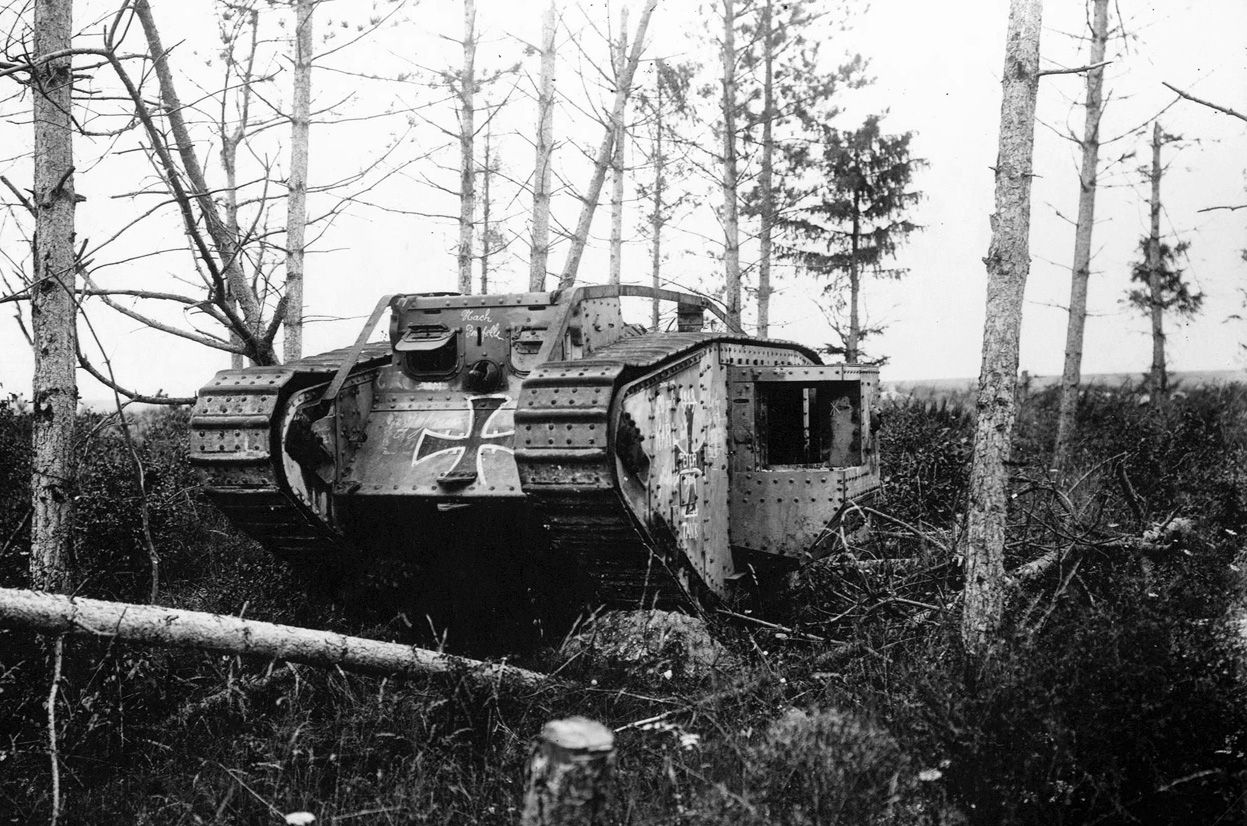 A British-made Mark IV tank, captured and re-painted by Germans, now abandoned in a small wood.
