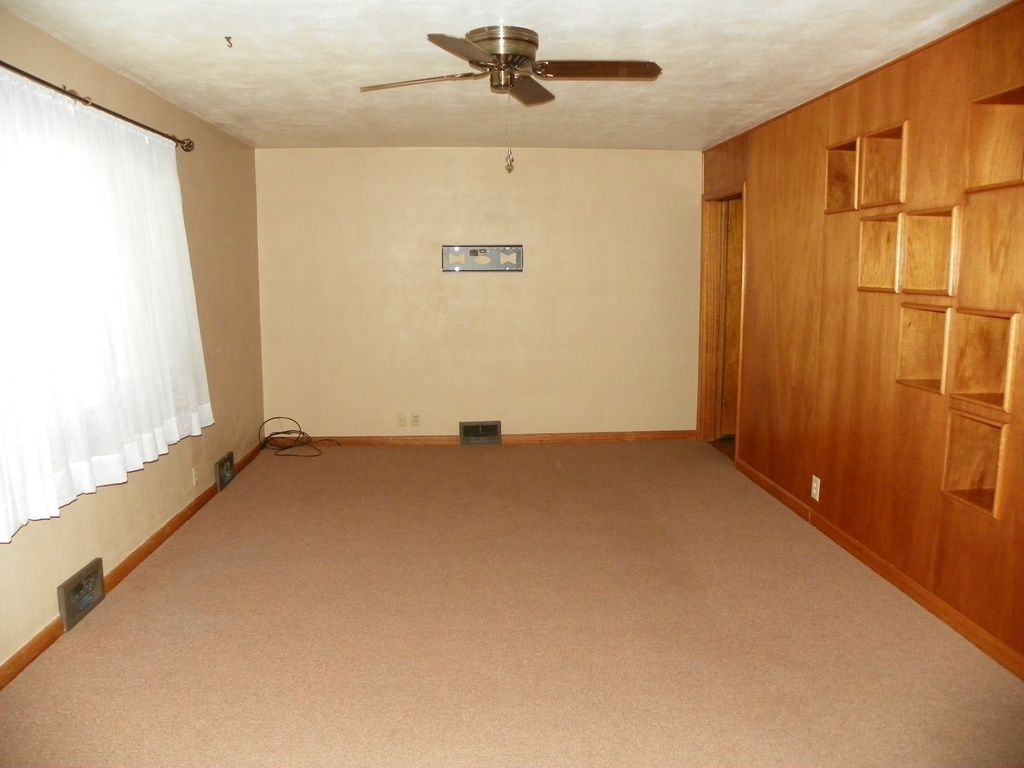 425 W 3rd St, Colby, KS 67701 | Zillow | Wood Panel Walls ...