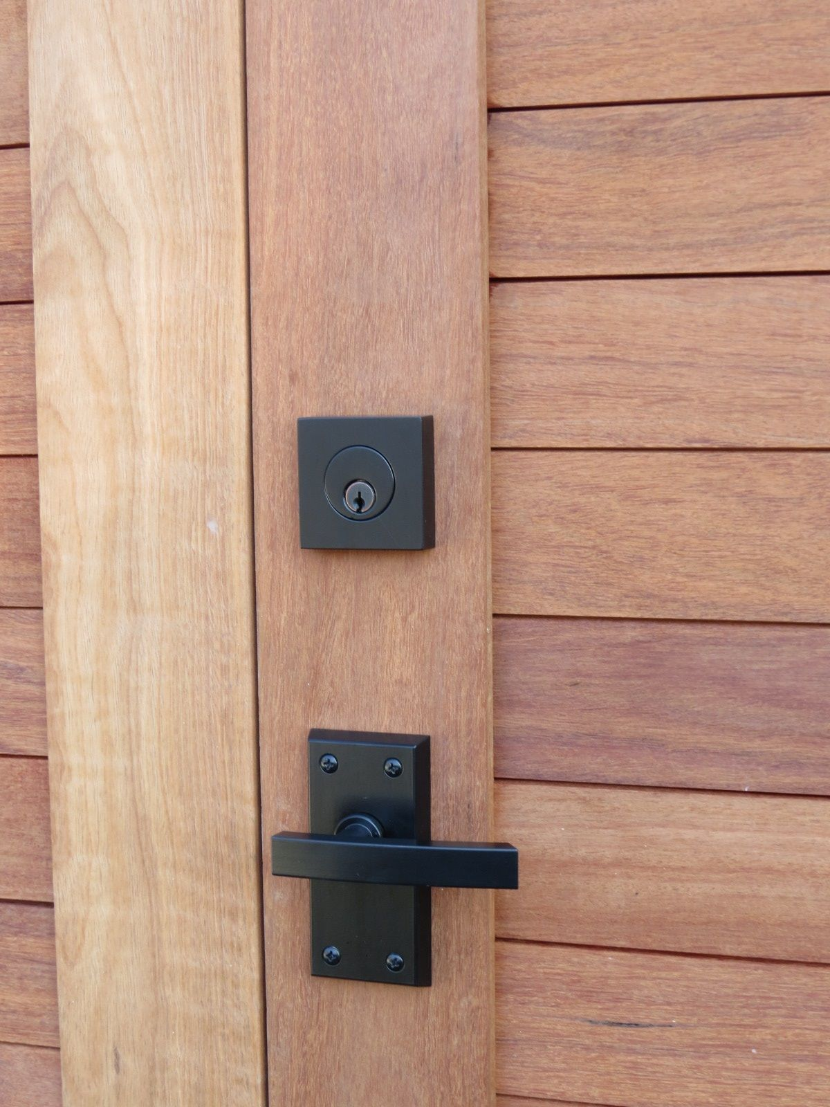 black contemporary lever gate latch on sapele wood gate Thousand