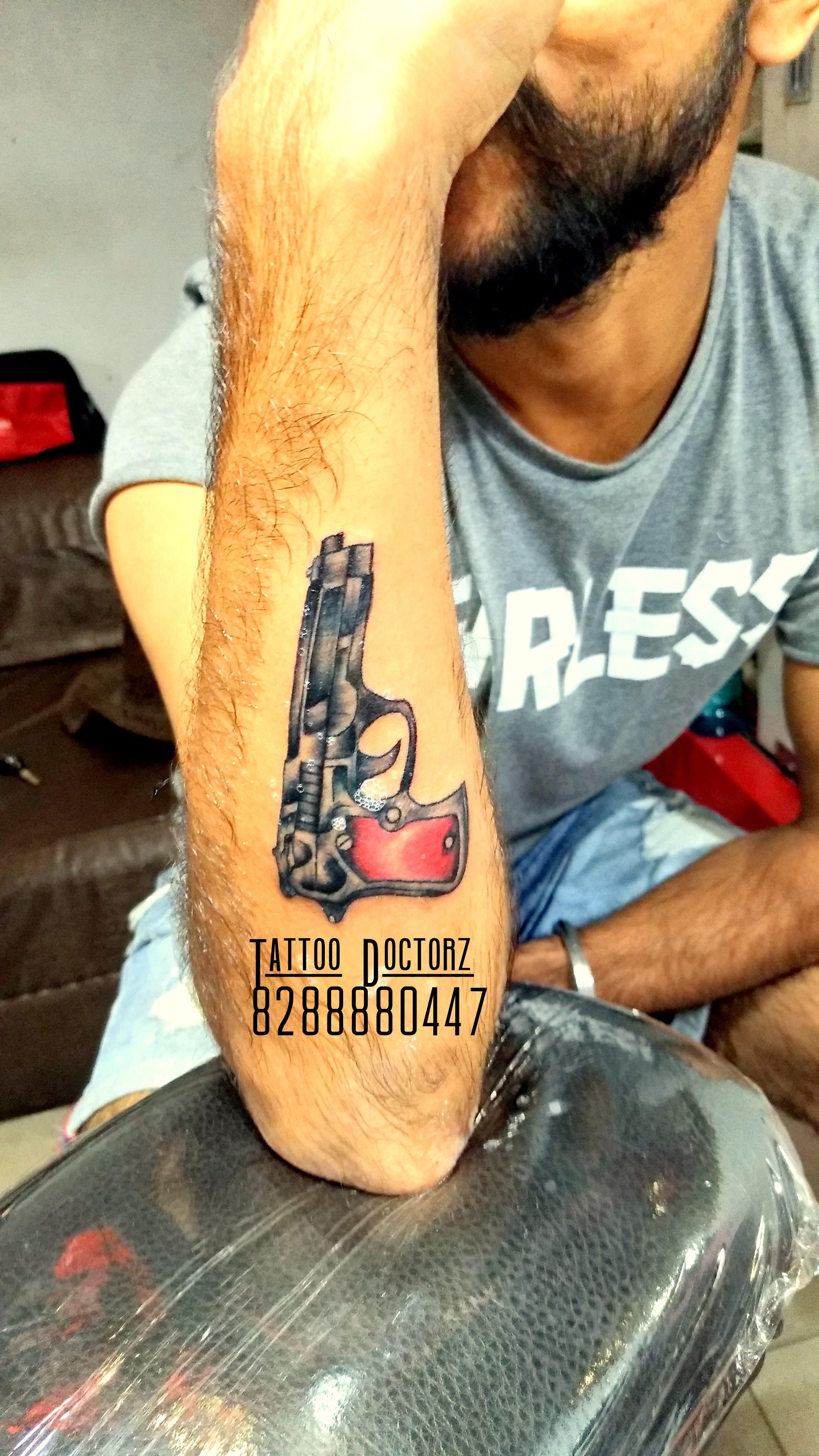 3d weapon tattoo done by tattoo doctorz contact us