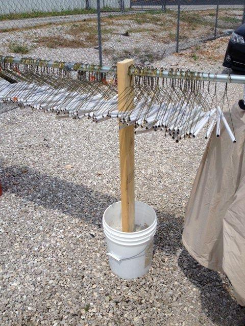 Bucket/post | Yard sale clothes rack, Yard sale clothes ...