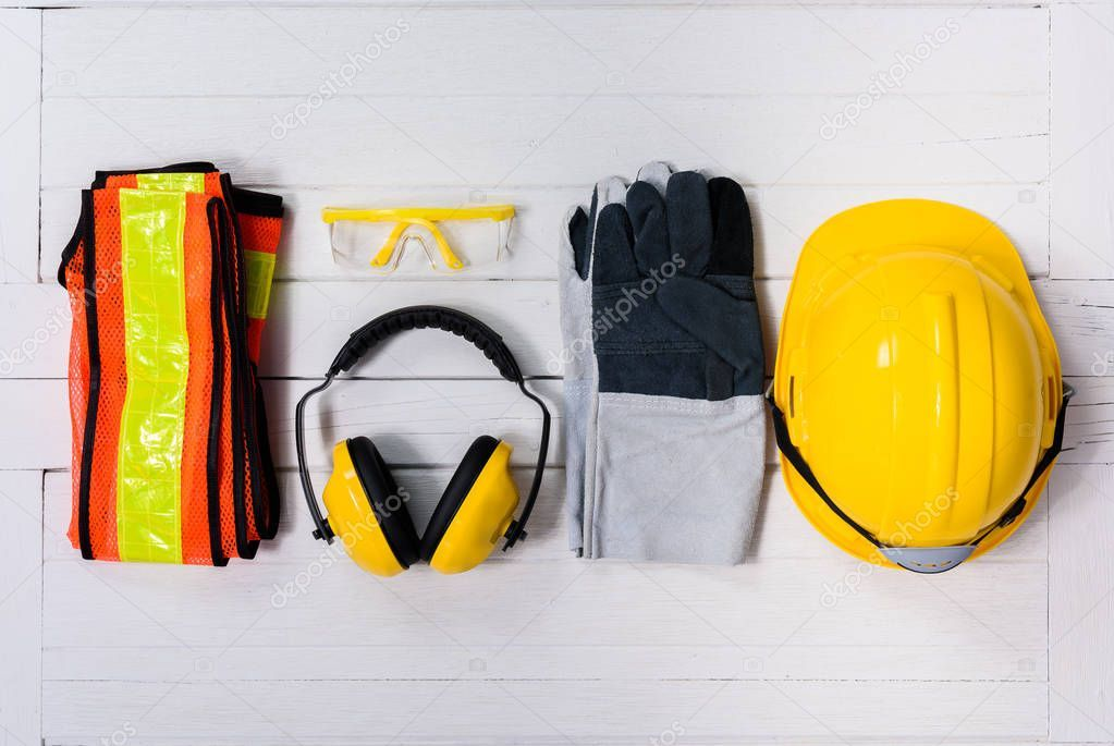 Standard Construction Safety Equipment White Wooden Background Top View Safety In 2020 Construction Safety Safety Equipment Wooden Background