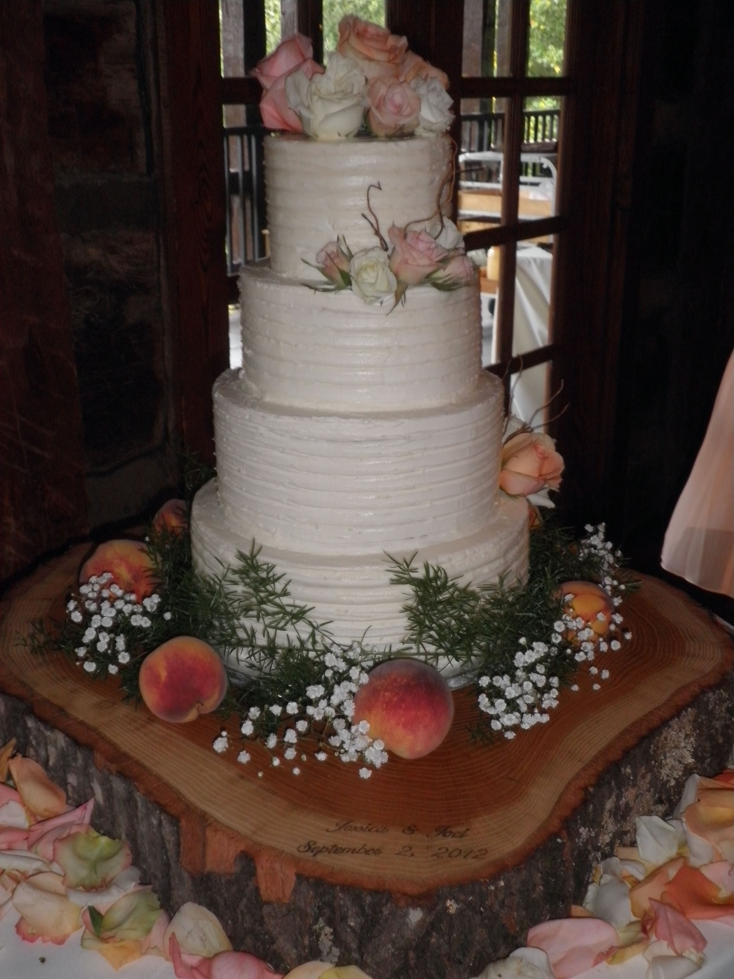 Four Tier Rustic Butter Cream Wedding Cake With Flowers