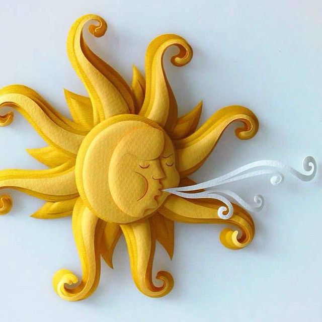 On allthingspaper.net today, an interview with professional paper artist Patricia Lima. She creates paper sculpture illustrations like this sun for children's books and advertisements.