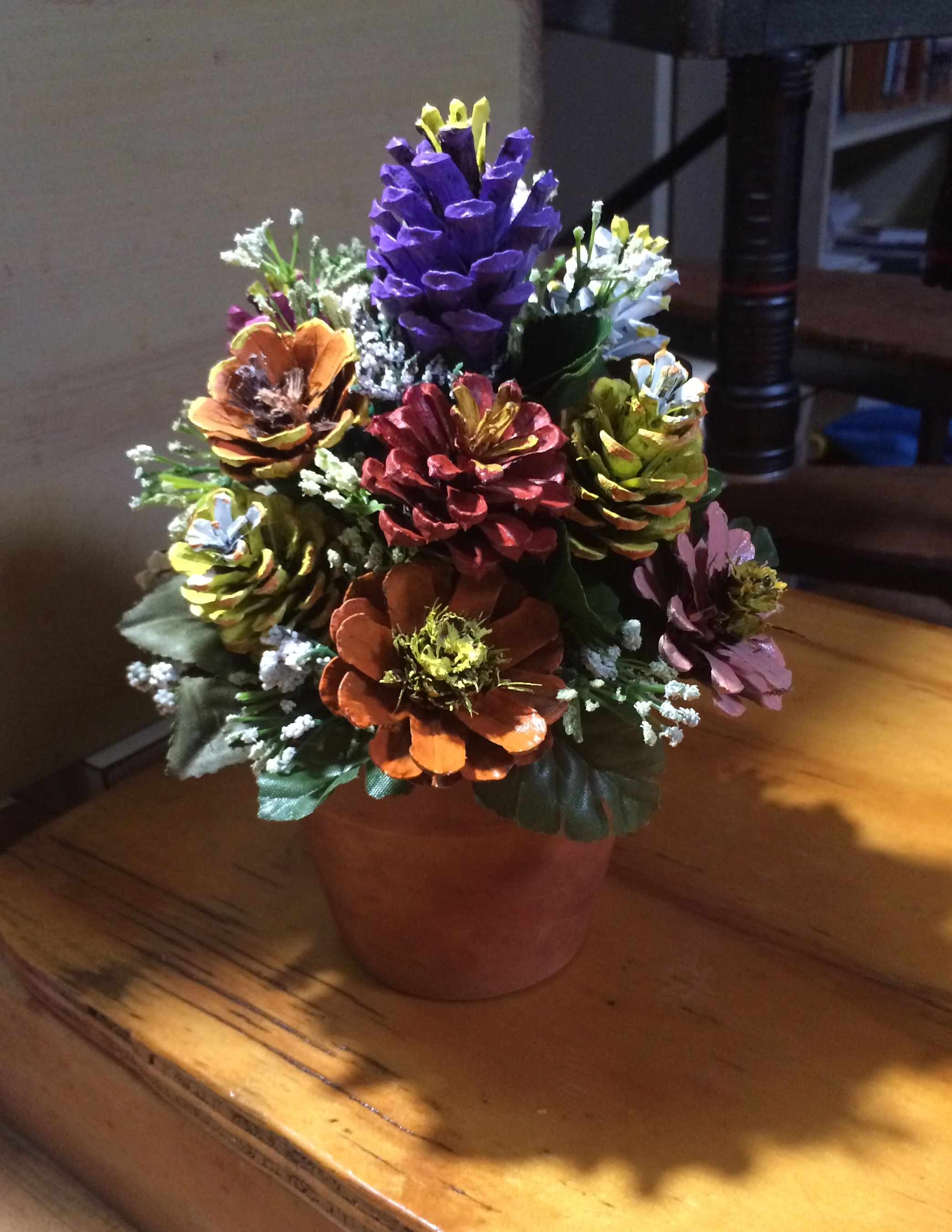 Pinecone flowers in terra cotta pot by Cat #pineconeflowers