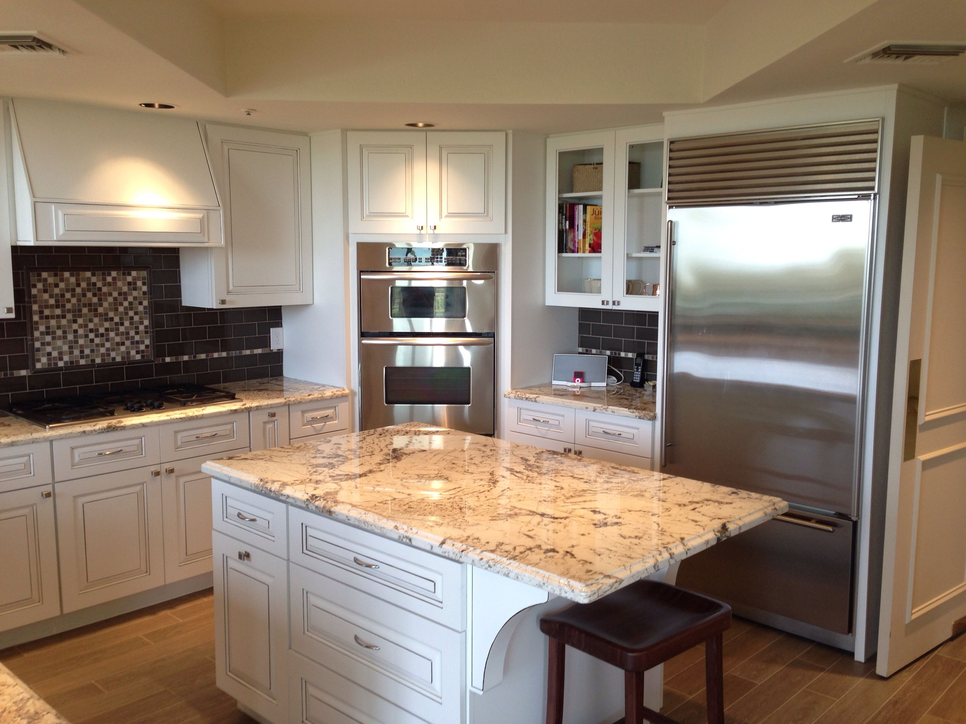 White Raised Panel Cabinets And Island Granite Countertops And