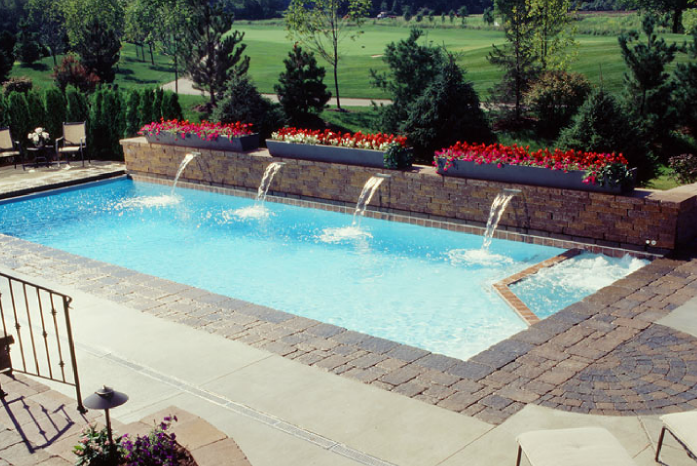 Amazing modern pool design by Classic Pool & Patio with water ...