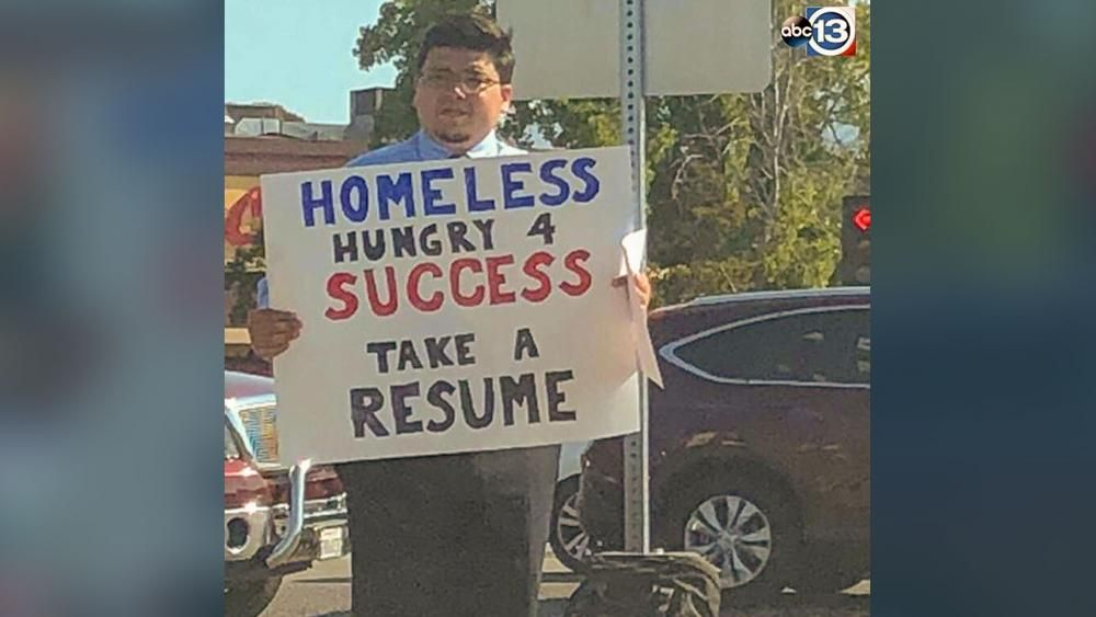 Homeless Man Wearing a Suit and Tie Passes Out Resumes at