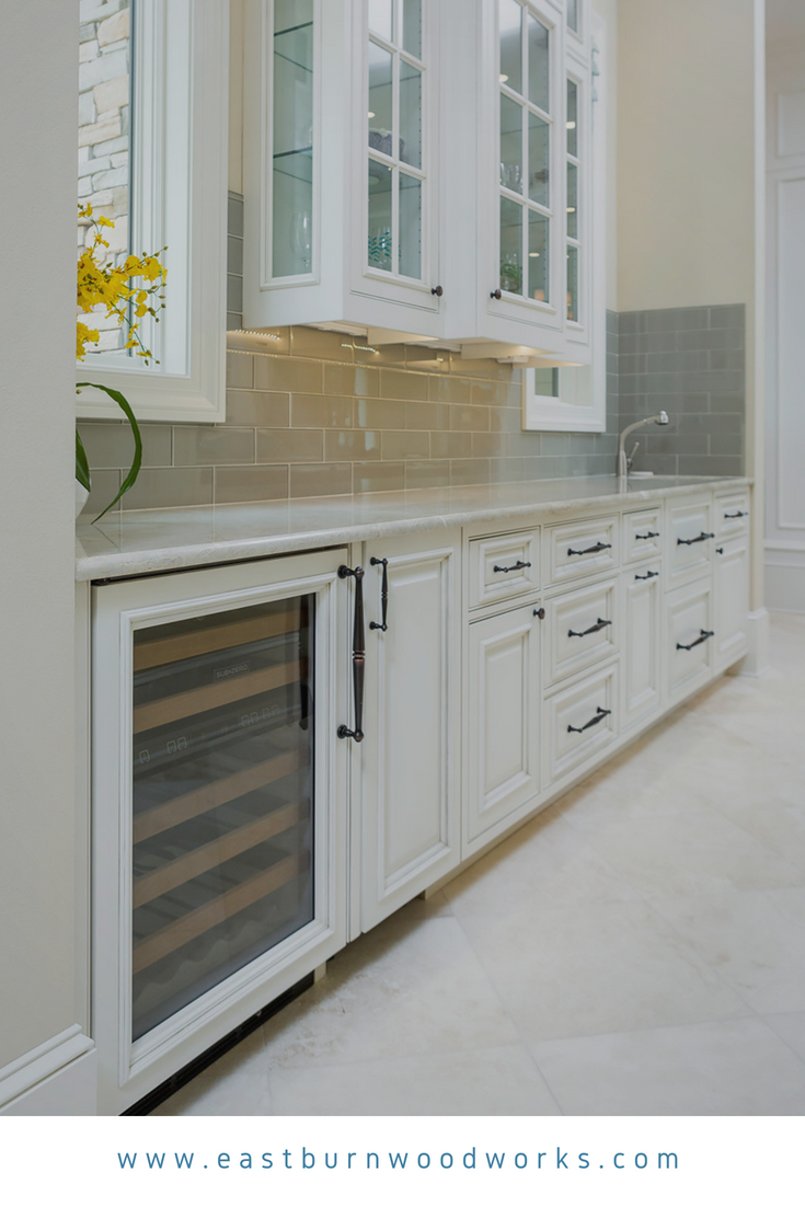 White kitchen cabinets with decorative raised panel doors ...