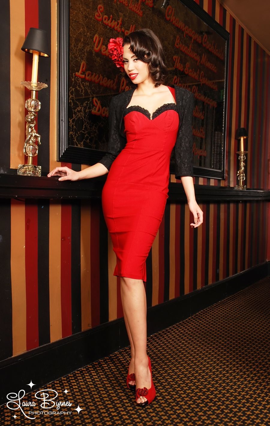 Masuimi Dress in Red Bengaline with Black Lace - Pinup Couture turns up the volume on our classic wiggle silhouette with amazing body enhancing details and our high-quality stretch bengaline fabric. Bust cups are built in and framed with lace trim, and the seaming is strategic to cinch in your waist line and emphasize your best features! Double kick pleats and zipper finish up the back for a dress as sexy as Masuimi herself.