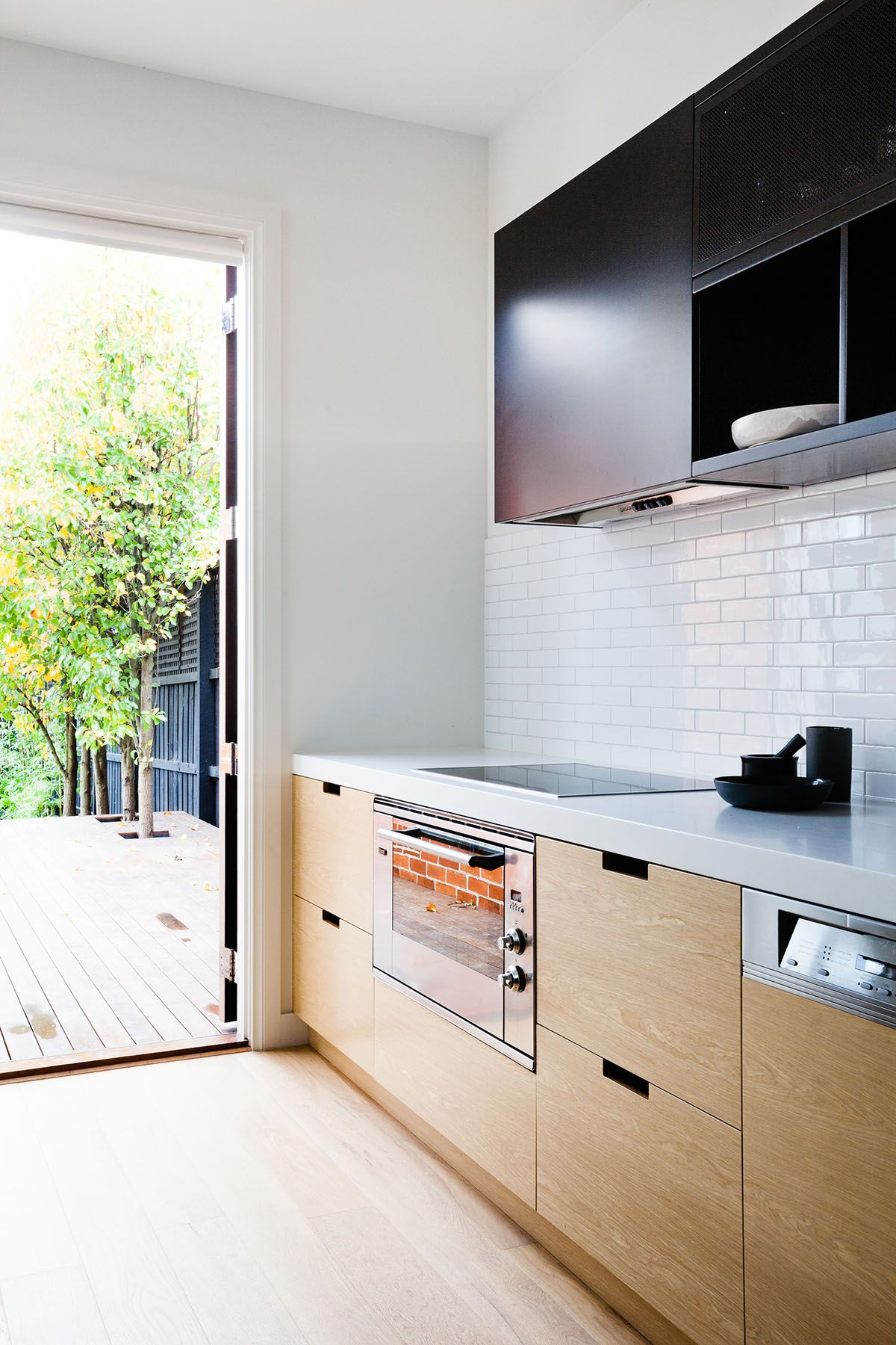 kitchen inside outside wooden cabinets white subway tiles