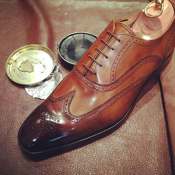 Burnish the toe on your brown dress shoes yourself. All you need is black  beeswax shoe polish, water and a shoe cloth.