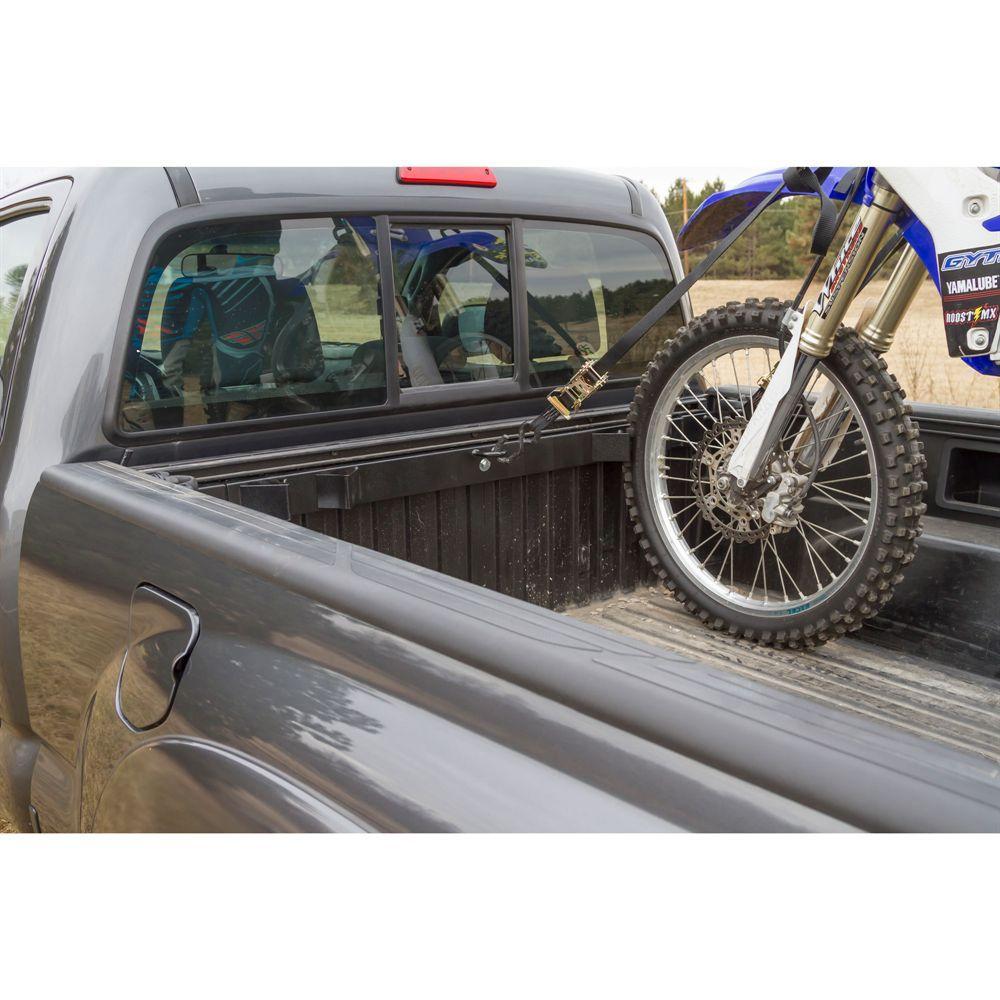 dirt bike secured in pickup truck bed