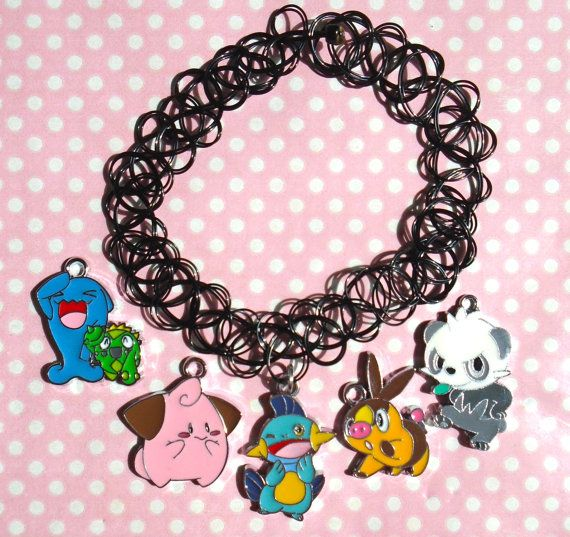 Cute Pokemon charms hung from a 90s style tattoo choker Super stretchy to slip over your head Double string Great 90s style piece!  Can be made using any of the coloured chokers available in my shop just leave a note