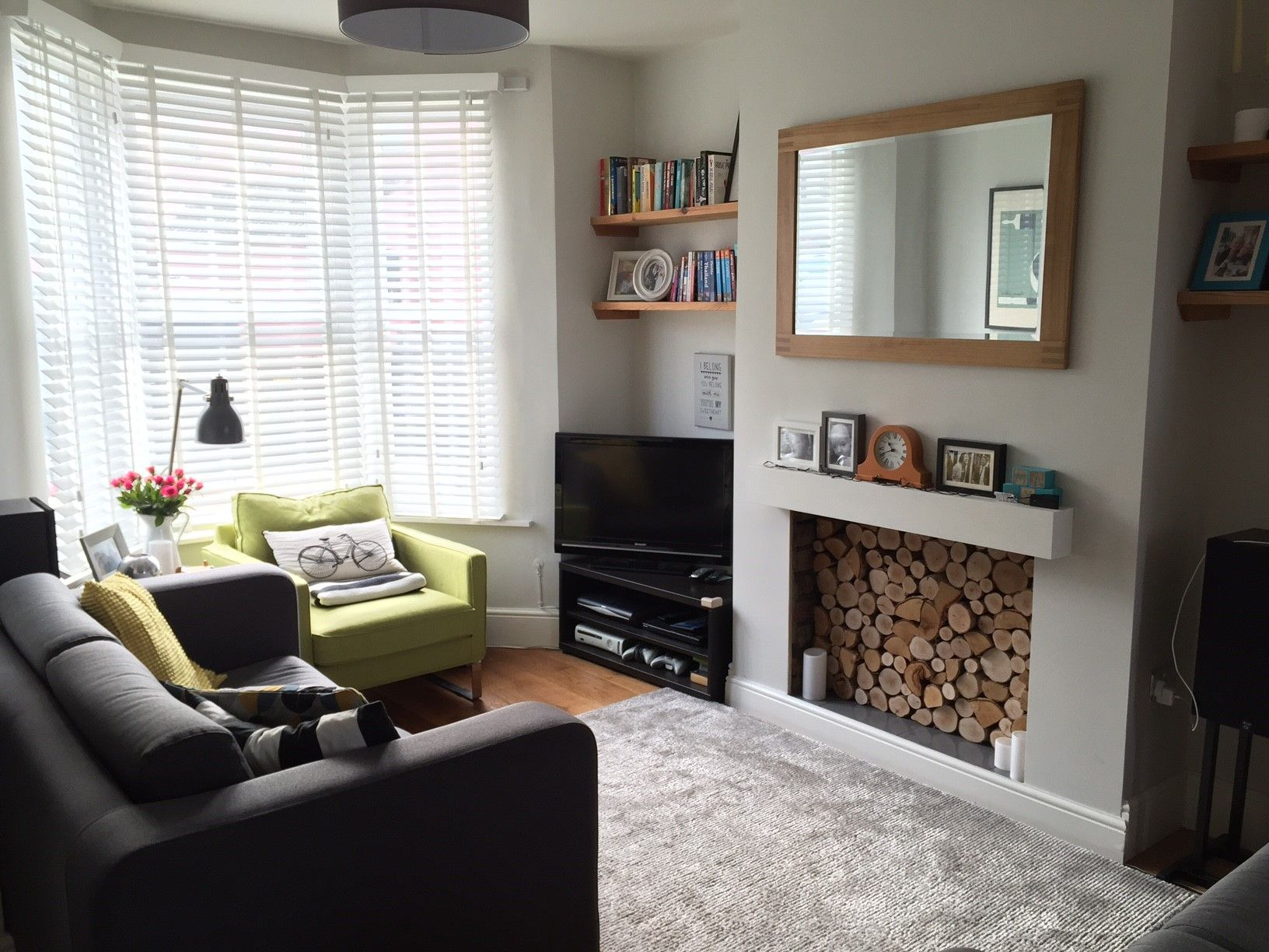 A beautiful front room finished off with the fireplace filled with  decorative silver birch round logs