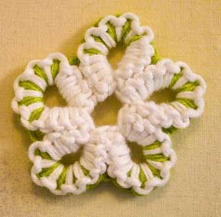 Multi coloured flower - interesting cross between crochet and tatting - called Crotat. Site has full tutorials to learn how