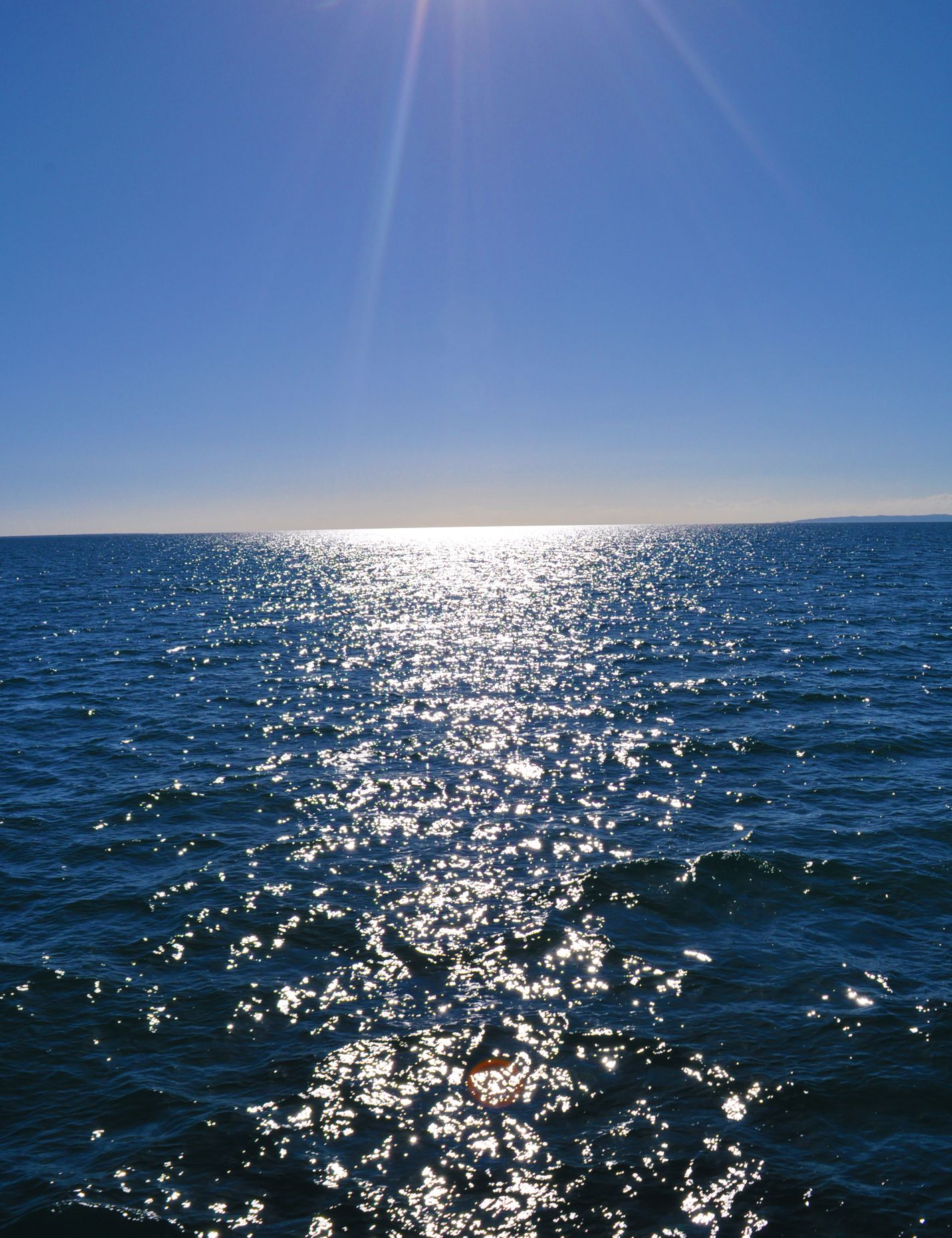 The sun shining on the crystal blue water off Moreton Island. You could see this for yourself on your next cruise - PO have added Moreton Island as a new port!