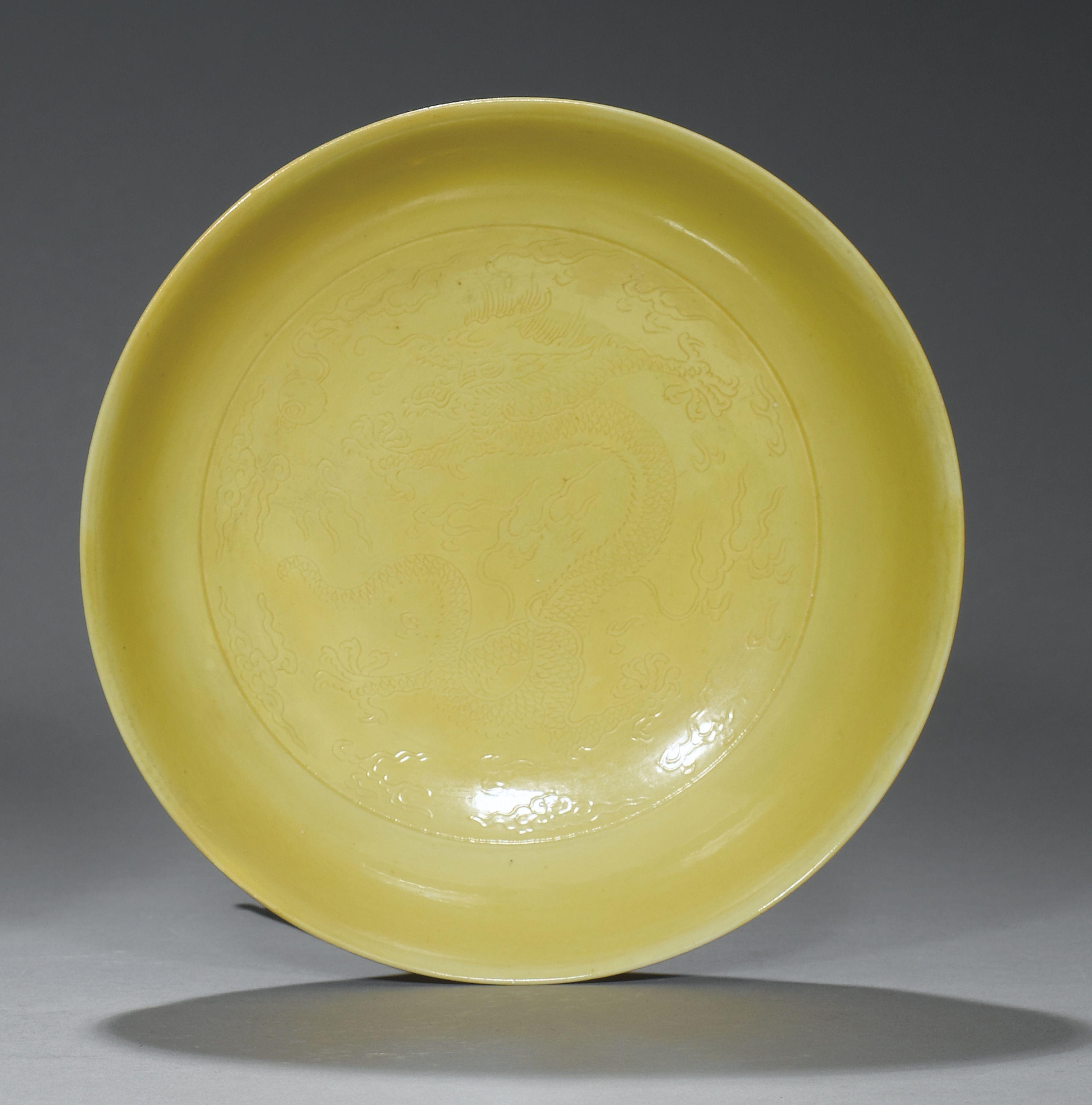 Yellow-glazed 'Dragon' dish, China, Qing Dynasty, Yongzheng mark and period (1723-1735)