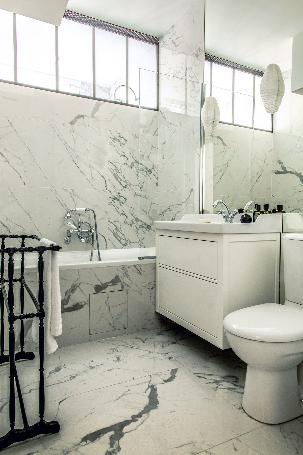 Huynh Completely Redesigned The Bath Lining It In White Carrara