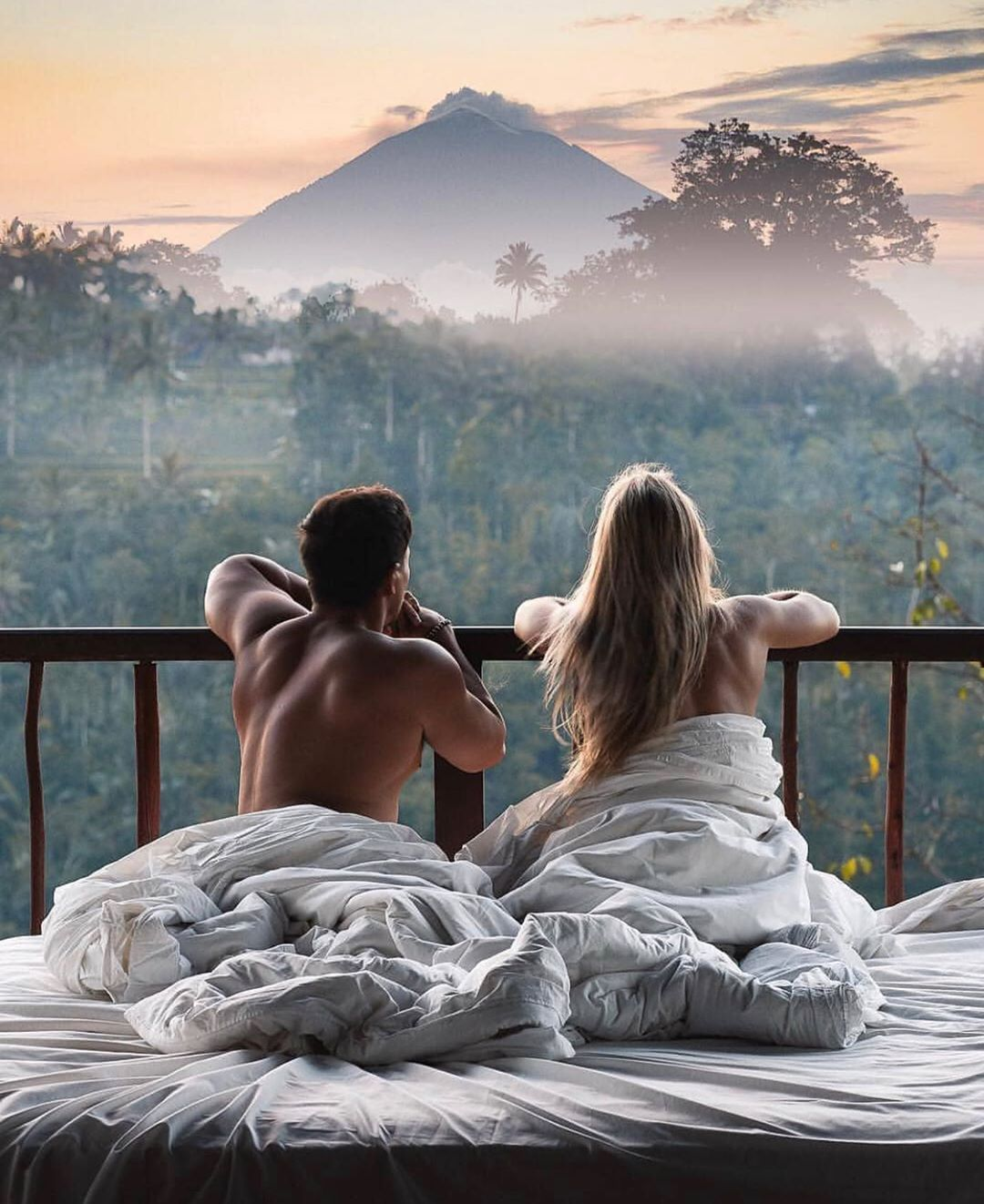 Waking up to incredible views like this ...Mount Agung letting off some steam in the background, jungle and rice paddie views in front,…