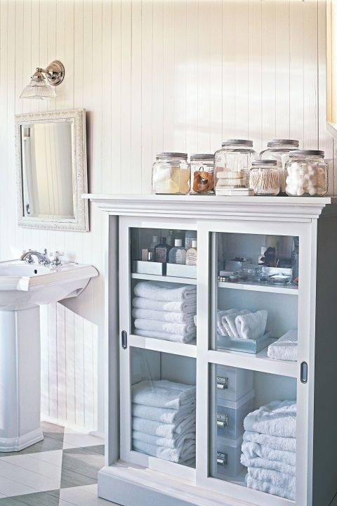 1. Neat & Narrow A shallow cabinet with sliding doors (Bellacor has a similar one) adds tons of storage in minimal space. 2. Glass Act No room to store everyday essentials (cotton balls, swabs) out of sight? Stash them in a set of glass canisters (The Container Store, starting at $4 each). 3. Tame The Towels Weed out extras: Stick to two sets per family member (assuming you do laundry once a week), plus two sets for guests. Now there's more room for makeup!