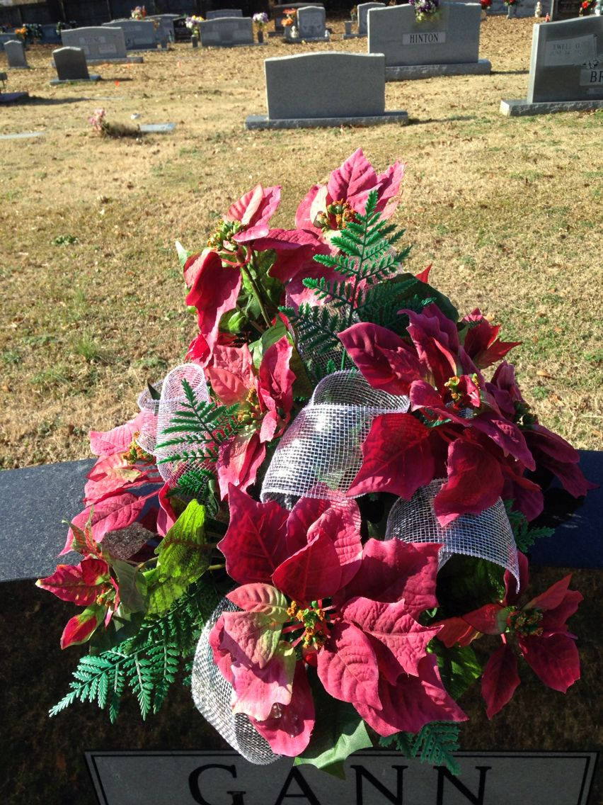 Cemetery Vase Using Rose Colored Poinsettias And Silver Ribbon