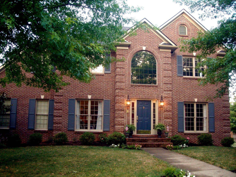 house classic red brick design with blue door ideas sense