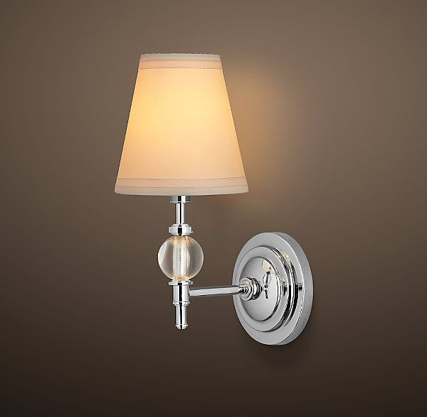 RH's Wilshire Single Sconce:Lead-crystal spheres magnify light, creating a warm glow and instant ambience.