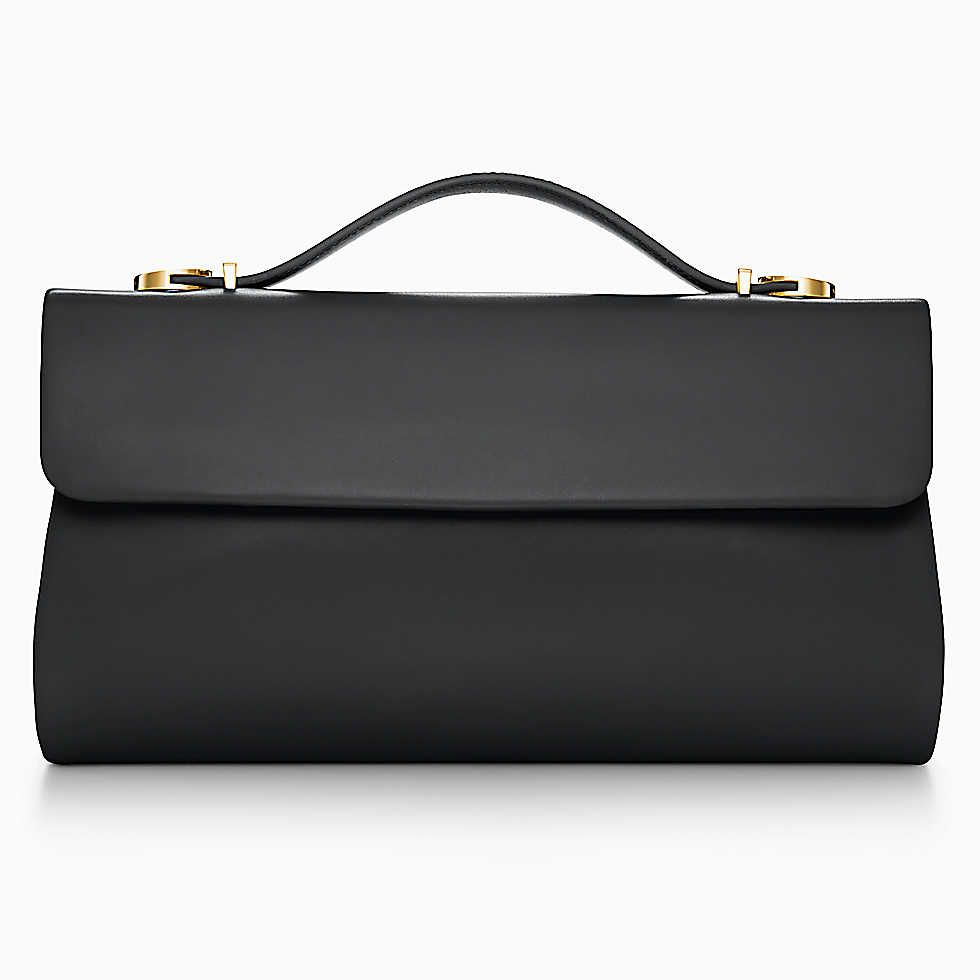 Sutton clutch in black smooth leather. More colors available ... 2b8f6fa51b4