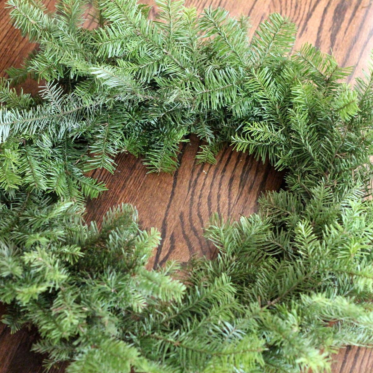 how to make a wreath using your leftover Christmas tree branches ...
