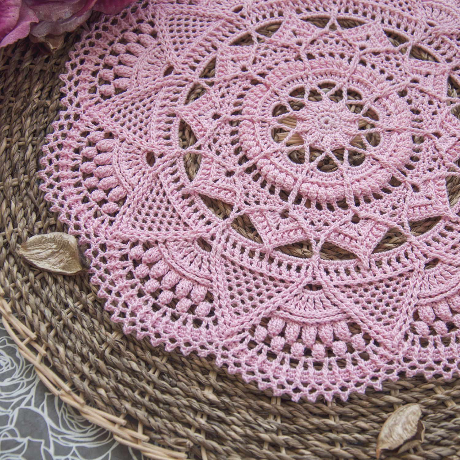 Textured crochet doily with intricate details. This ...
