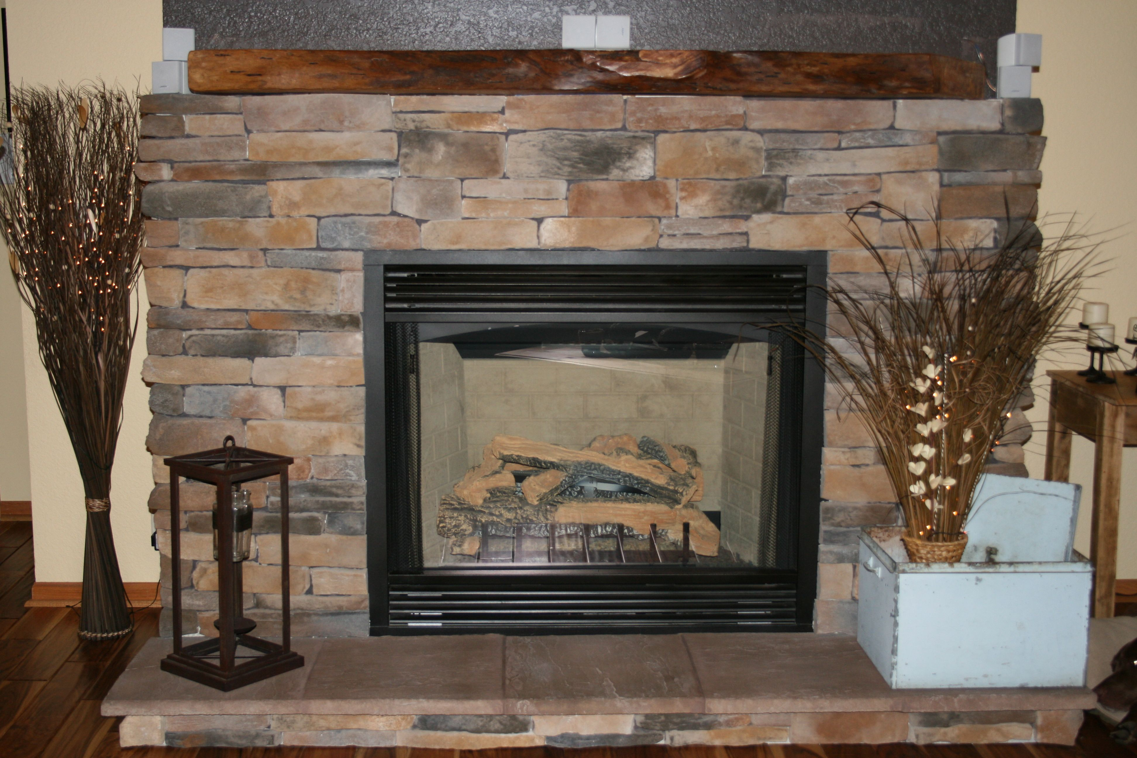 stacked stone fireplace with tree trunk mantle projects we have rh pinterest com