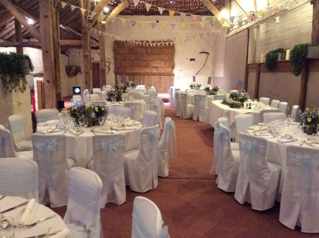 white linen wedding chair covers with palest blue organza