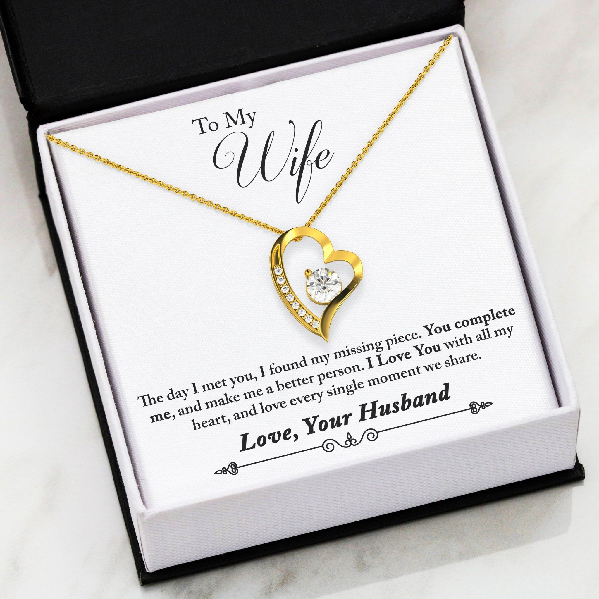 ♥ Valentine day gift for wife: - Thoughtful quote from Husband. To May Wife, The day I met you, I found my missing piece. You com complete me, and make me a better person. I Love You with all my heart, and love every single moment we share. Love, Your Husband.♥ Birthday gift for wife: - High polished heart pendant surrounding a flawless 6.5mm Cubic Zirconia, embellished with smaller Cubic Zirconia adding sparkle and shine. The pendant is available in 14k White Gold finish or 18k Yellow Gold fini