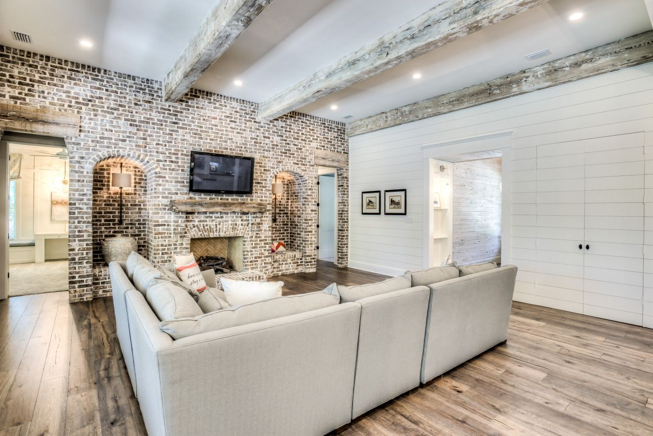 Accent wall fireplace along with wood beamsgives a lot