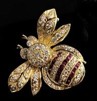 1940's Vintage Bumble Bee Pin of 18k yellow gold and rows of rubies and diamonds.