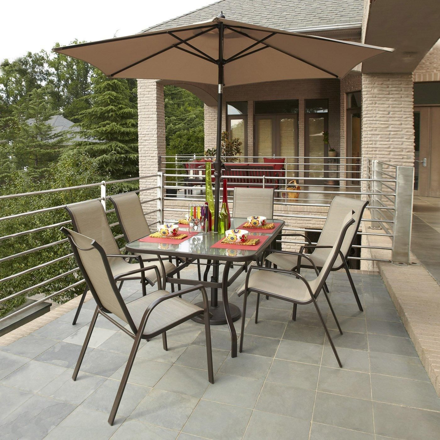 This 7Piece outdoor dining set has a tempered glass table