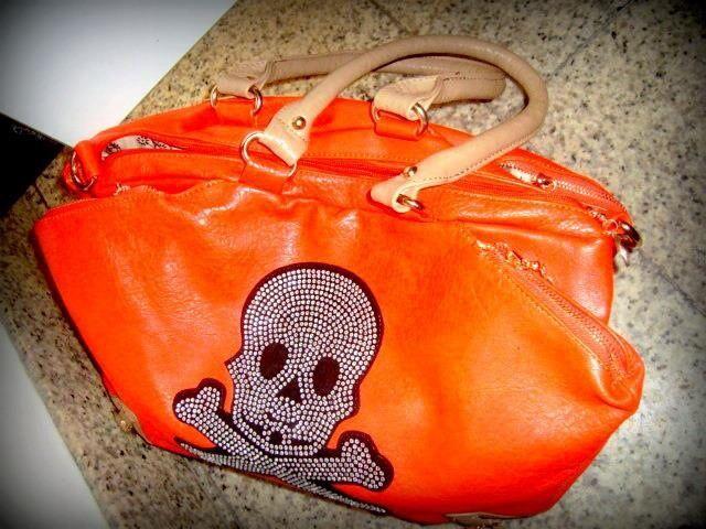 Bolsa laranja caveirinhas...